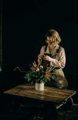 women taking care of flower at flower shop